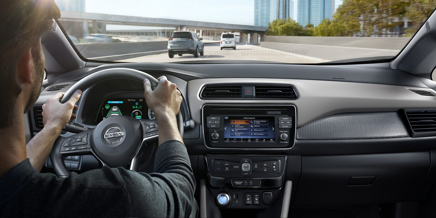Nissan LEAF interior showing person driving on a highway